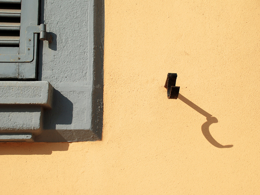 Shadow on Yellow Wall